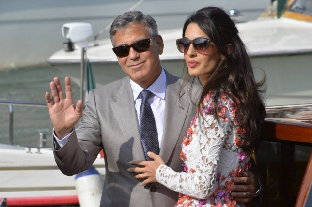 "US actor George Clooney and his wife Amal Alamuddin stand on a taxi boat on the Grand Canal on September 28, 2014 in Venice. Hollywood heartthrob George Clooney and Lebanese-British lawyer Amal Alamuddin married in Venice on Saturday September 27, 2014 before partying the night away with their A-list friends in one of the most high-profile celebrity weddings in years. ""George Clooney and Amal Alamuddin were married today (September 27) in a private ceremony in Venice, Italy,"" Clooney spokesman Stan Rosenfield said. The announcement came as a surprise as the pair were not expected to officially tie the knot until Monday, though they are still tipped for a civil ceremony at the town hall to officialise the marriage under Italian law. AFP PHOTO / ANDREAS SOLARO (Photo credit should read ANDREAS SOLARO/AFP/Getty Images)"