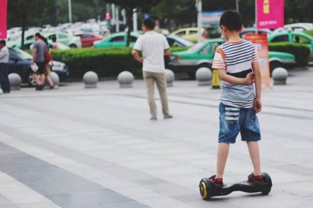 Boy In Segway On Street