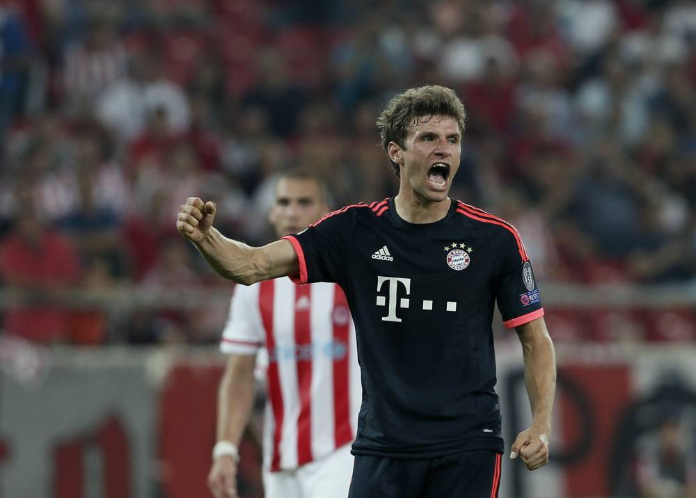 Bayern's Thomas Muller celebrates his second goal and the third goal for his team during a Champions League Group F soccer match between Olympiakos and Bayern Munich at Georgios Karaiskakis stadium in Piraeus port, near Athens, Wednesday, Sept. 16, 2015. (AP Photo/Petros Giannakouris)