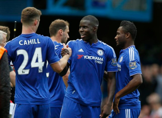 Chelsea's Kurt Zouma, centre is congratulated by teammate Chelsea's Gary Cahill after the end of the English Premier League soccer match between Chelsea and Arsenal at Stamford Bridge stadium in London, Saturday, Sept. 19, 2015. Zouma scored the first goal in Chelsea's 2-0 win over Arsenal.(AP Photo/Alastair Grant)
