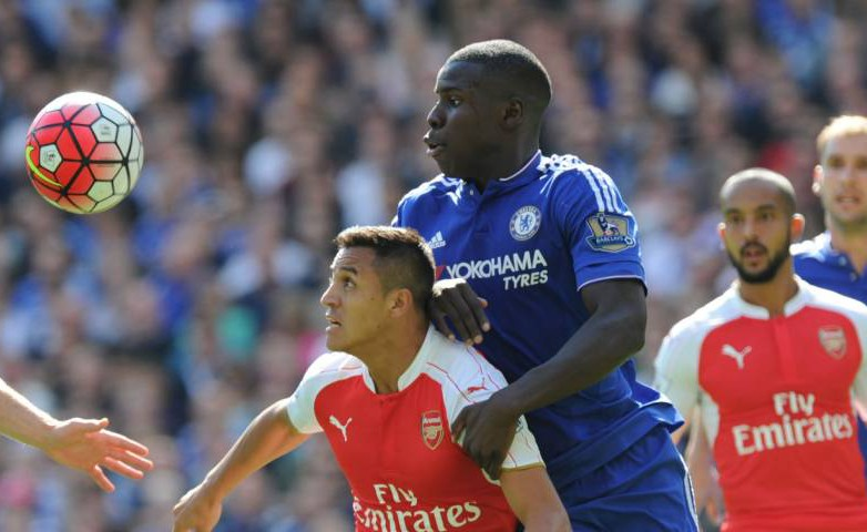 LONDON, ENGLAND - SEPTEMBER 19: Alexis Sanchez of Arsenal challenged by Kurt Zouma of Chelsea during the Barclays Premier League match between Chelsea and Arsenal on September 19, 2015 in London, United Kingdom. (Photo by Stuart MacFarlane/Arsenal FC via Getty Images)