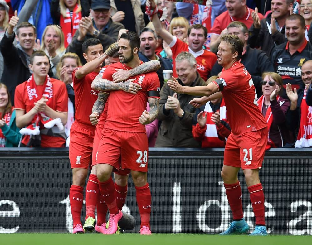Liverpool's English striker Danny Ings (C) celebrates with teammates after scoring during the English Premier League football match between Liverpool and Norwich City at the Anfield stadium in Liverpool, north-west England on September 20, 2015. AFP PHOTO / PAUL ELLIS RESTRICTED TO EDITORIAL USE. No use with unauthorized audio, video, data, fixture lists, club/league logos or 'live' services. Online in-match use limited to 75 images, no video emulation. No use in betting, games or single club/league/player publications.PAUL ELLIS/AFP/Getty Images