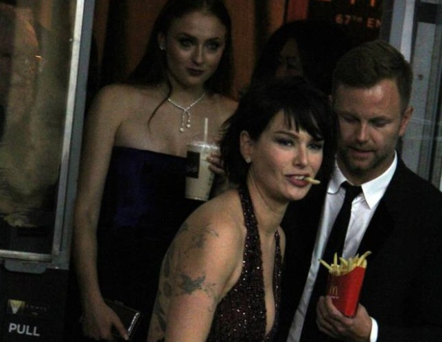 """""""Game of Thrones"""" star Lena Headey tries to hide the fact that she's eating McDonald's French Fries as she walk into the press room at the Emmys, Microsoft Theater <P> Pictured: Lena Headey <B>Ref: SPL1131451 210915 </B><BR /> Picture by: Splash News<BR /> </P><P> <B>Splash News and Pictures</B><BR /> Los Angeles: 310-821-2666<BR /> New York: 212-619-2666<BR /> London: 870-934-2666<BR /> photodesk@splashnews.com<BR /> </P>"""