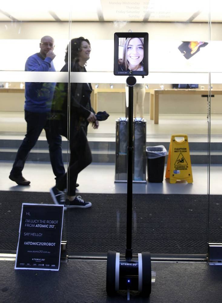 Lucy an Atomic 212 Robot stands third in the line to purchase the new iPhone 6S, outside the Apple Store, in Sydney, Australia, Friday, Sept. 25, 2015. The robot, controlled via the 4G network allows owner Lucy Kelly of Sydney to finalize her purchase of a new iPhone 6s remotely. Apple is counting on sales of the new iPhones to maintain its position as one of the most profitable, and valuable, companies in the world. (AP Photo/Glenn Nicholls)