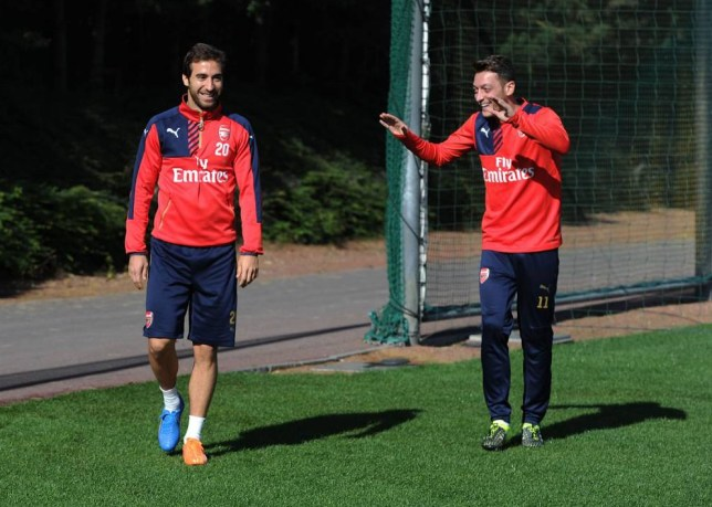 ST ALBANS, ENGLAND - SEPTEMBER 25:  (L-R) Mathieu Flamini and Mesut Ozil of Arsenal joke about before a training session at London Colney on September 25, 2015 in St Albans, England.  (Photo by Stuart MacFarlane/Arsenal FC via Getty Images)