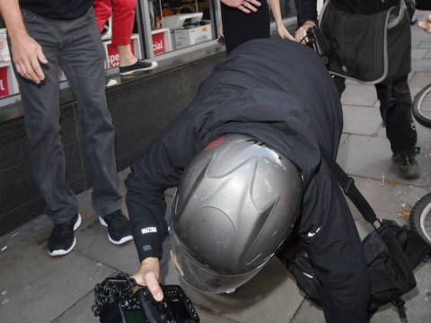 Karma strikes! Clumsy photographer takes a tumble trying to snap Selena Gomez. She laughs