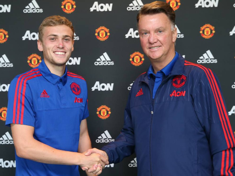 MANCHESTER, ENGLAND - SEPTEMBER 25: (EXCLUSIVE COVERAGE) James Wilson of Manchester United shakes hands with Manager Louis van Gaal after signing a new contract with the club at Aon Training Complex on September 25, 2015 in Manchester, England. (Photo by John Peters/Man Utd via Getty Images)
