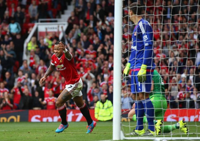 MANCHESTER, ENGLAND - SEPTEMBER 26: Memphis Depay of Manchester United celebrates scoring his team's first goal during the Barclays Premier League match between Manchester United and Sunderland at Old Trafford on September 26, 2015 in Manchester, United Kingdom. (Photo by Ian Walton/Getty Images)