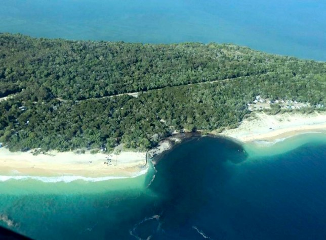 epa04951837 A handout image made available by Higgins Storm Chasing shows a 150-metre long and 50 meter wide sinkhole which opened up at MV Beagle Campground, north of Queensland's Rainbow Beach, at Inskip Point, Australia, 27 September 2015. According to media reports on 27 September, a massive sinkhole opened at a popular beach on Queensland's Sunshine Coast swallowing a car, a caravan, a camping trailer and tents. After the accident, 140 people were evacuated from the camping ground on 26 September night, media reported. EPA/HIGGINS STORM CHASING -- BEST QUALITY AVAILABLE -- AUSTRALIA AND NEW ZEALAND OUT HANDOUT EDITORIAL USE ONLY/NO SALES