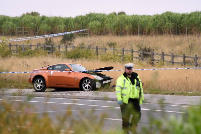 Police at the scene of a fatal crash involving a quad bike and a bronze Nissan 350z sports car (pictured) on the A6201 between Upton and Hemsworth, West Yorkshire, which happened at around 12:34 am today (Sunday 27 September 2015). The three people on the quad bike were killed and two men were arrested and are in custody.