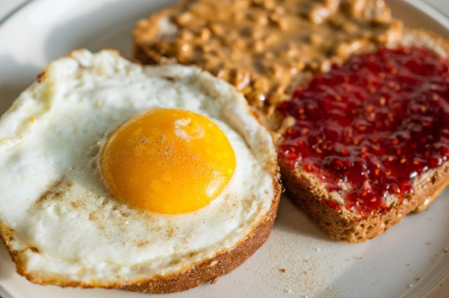 High angle close up of delicious fried egg and toast with peanut butter and jelly Michael Shum