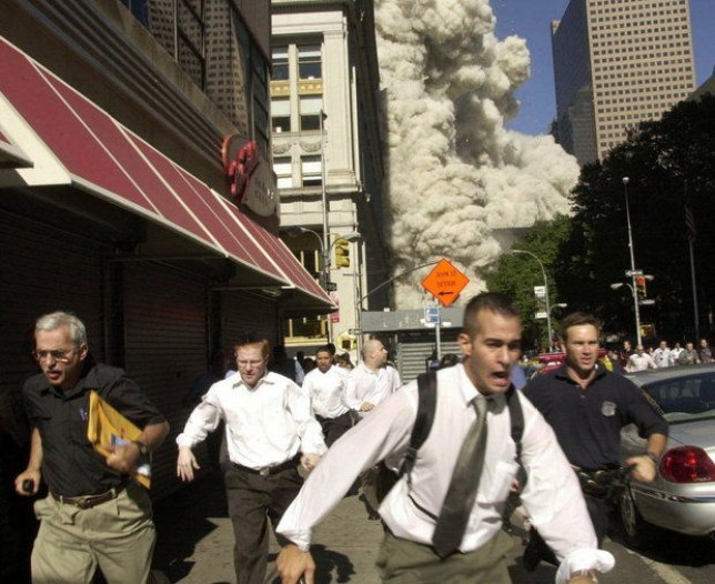Workers run from the aftermath of 9/11 (Picture: AP Photo/Suzanne Plunkett)