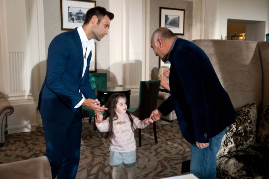 FROM ITV STRICT EMBARGO - No Use Before Tuesday 20 October 2015 Emmerdale - Ep 73233 Thursday 29 October 2015 Rishi Sharma [BHASKER PATEL] is delighted to be reunited with his son Nikhil Sharma [RIK MAKAREM] and granddaughter Molly at the meeting. But can Rishi convince Nikhil to stay on longer? Nikhil still has his demons, regarding how Gennie died, and seemingly is unable to forgive Debbie for the part she played. Picture contact: david.crook@itv.com on 0161 952 6214 Photographer - Amy Brammall This photograph is (C) ITV Plc and can only be reproduced for editorial purposes directly in connection with the programme or event mentioned above, or ITV plc. Once made available by ITV plc Picture Desk, this photograph can be reproduced once only up until the transmission [TX] date and no reproduction fee will be charged. Any subsequent usage may incur a fee. This photograph must not be manipulated [excluding basic cropping] in a manner which alters the visual appearance of the person photographed deemed detrimental or inappropriate by ITV plc Picture Desk. This photograph must not be syndicated to any other company, publication or website, or permanently archived, without the express written permission of ITV Plc Picture Desk. Full Terms and conditions are available on the website www.itvpictures.com
