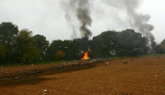 """Videograbs from footage taken moments after a light aircraft crashed near Chigwell, Essex. See SWNS story SWPLANE; This is the shocking footage captured moments after the fatal plane crash on Saturday morning that saw the tragic deaths of both people on board. The eight-seater plane, being operated by a private charter company, smashed into the ground and exploded in a """"colossal fireball"""" according to one eyewitness, who was on the scene moments after the crash. The tragedy happened at around 10:20am outside Chigwell, Essex, and tragically claimed the lives of both those on board. Eyewitness Deivaras Zakrasas (doub corr) says the ground shook after the plane hit the ground. The 28-year-old, who lives in Chingwell, said: """"I didn't see the plane before it crashed, but I heard a massive bang."""