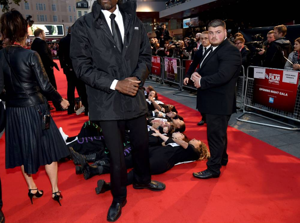 Domestic violence protestors crash the red carpet at the Suffragette premiere in London