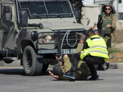 Palestinian man wearing 'press t-shirt' shot dead after stabbing Israeli soldier