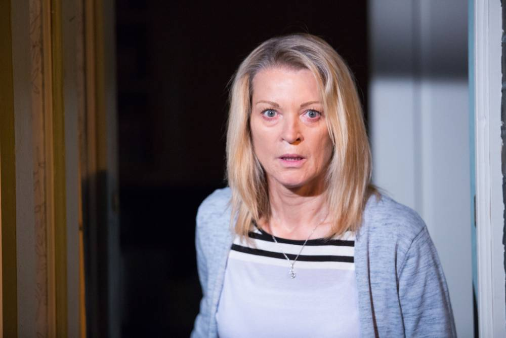 WARNING: Embargoed for publication until 00:00:01 on 20/10/2015 - Programme Name: EastEnders - TX: 30/10/2015 - Episode: 5164 (No. n/a) - Picture Shows: A frightened Kathy looks outside. Kathy Sullivan (GILLIAN TAYLFORTH) - (C) BBC - Photographer: Guy Levy
