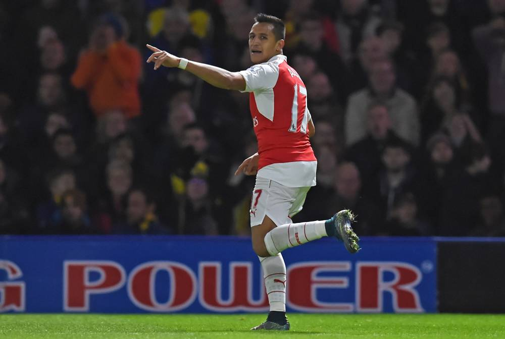 Arsenal's Chilean striker Alexis Sanchez celebrates after scoring the opening goal of the English Premier League football match between Watford and Arsenal at Vicarage Road Stadium in Watford, north of London on October 17, 2015. AFP PHOTO / PAUL ELLIS RESTRICTED TO EDITORIAL USE. No use with unauthorized audio, video, data, fixture lists, club/league logos or 'live' services. Online in-match use limited to 75 images, no video emulation. No use in betting, games or single club/league/player publications.PAUL ELLIS/AFP/Getty Images