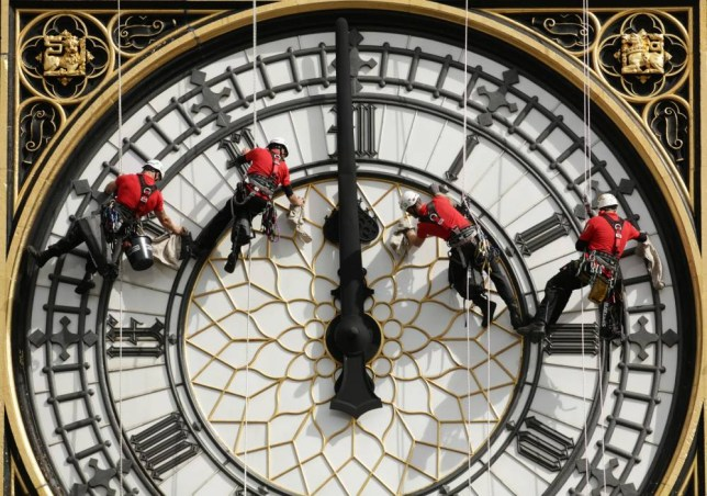 "File photo dated 18/08/14 of a specialist technical abseil team cleaning and inspecting one of the four faces of the Great Clock, otherwise known as Big Ben, at the Houses of Parliament in London, as the taxpayer faces a bill of up to £40 million to keep the famous ""bongs"" of Big Ben sounding, according to a report. PRESS ASSOCIATION Photo. Issue date: Saturday October 17, 2015. Parliament's Great Clock is said to be so dilapidated that it could grind to a halt altogether unless drastic repairs are carried out. See PA story POLITICS Clock. Photo credit should read: Yui Mok/PA Wire"