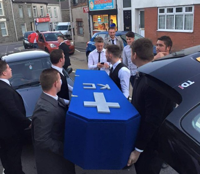 "A funeral was held by 50 friends for their ""lost"" friend because he's all loved up with his new girlfriend. Keiran Cable, 20, was shocked to be attending his own funeral service when he thought he was being taken to the pub to watch rugby. Reformed ""lad's lad"" Keiran hadn't been seen out on the town since he started seeing his beautiful new girlfriend over the last 18 months. Pictured here is Keiran Cable's mock funeral service. © WALES NEWS SERVICE"