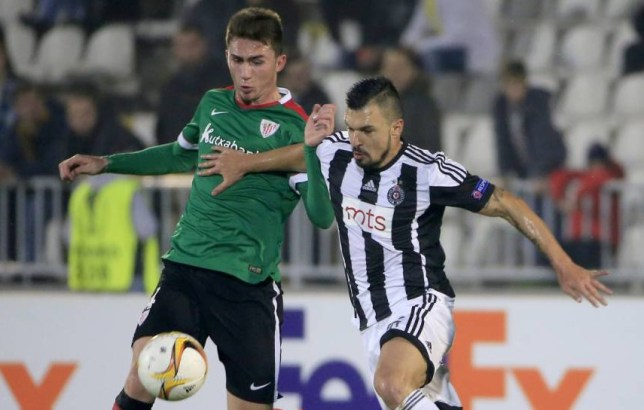 BELGRADE, SERBIA - OCTOBER 22: Valeri Bozinov (R) of FK Partizan competes for the ball agaist Aymeric Laporte (L) of Athletic Club during the UEFA Europa League match between FK Partizan v Athletic Club at Stadium FK Partizan on October 22, 2015 in Belgrade, Serbia. (Photo by Srdjan Stevanovic/Getty Images)