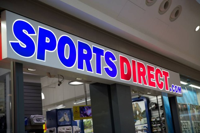 """Sports Direct retail sign. Billionaire Mike Ashley is today revealed as the biggest employer to use the soon-to-be illegal """"zero hour"""" contracts that potentially stop the 20,000 part-time staff at his retail empire getting a second job. The policy was described as unfair and exploitative by MPs and campaigners and means 90 per cent of workers at his Sports Direct stores have no guaranteed working hours and must seek permission from management to work elsewhere."""