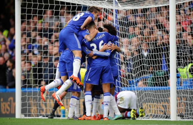 Diego Costa of Chelsea is surrounded by team-mates as he celebrates his goal, 1-0, during the Barclays Premier League match between Chelsea and Aston Villa played at Stamford Bridge, London on October 17th 2015BPI / Joe Toth