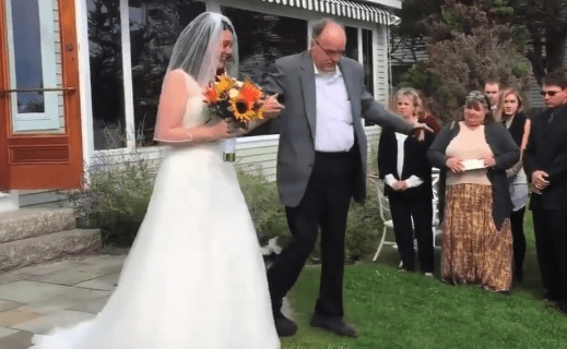 father of the bride gets out of wheelchair to walk daughter down the aisle
