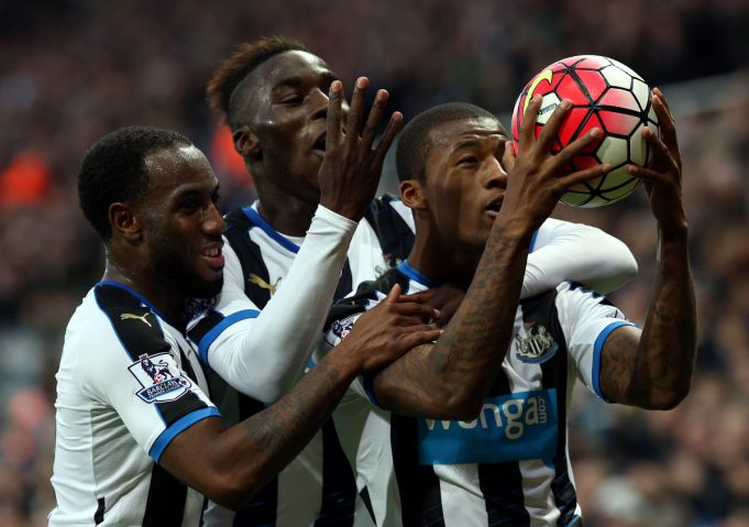 Newcastle United's Georginio Wijnaldum , right, celebrates his fourth goal during their English Premier League soccer match between Newcastle United and Norwich City at St James' Park, Newcastle, England, Sunday, Oct. 18, 2015. (AP Photo/Scott Heppell)
