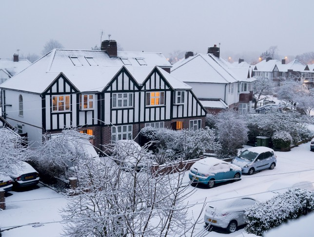 Suburban snow-topped houses in Surrey (Picture: Charles Bowman/robertharding/REX Shutterstock)