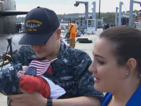 Touching moment U.S. Navy sailors meet their babies for the first time