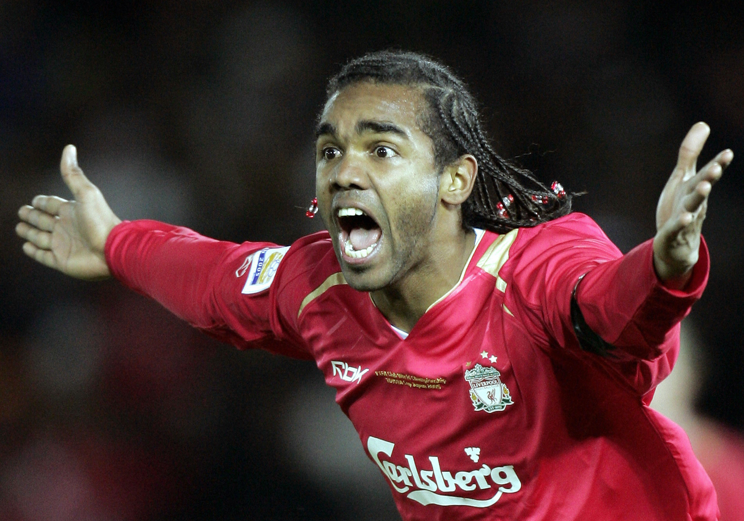 Former Liverpool striker Florent Sinama Pongolle is on trial at Dundee United