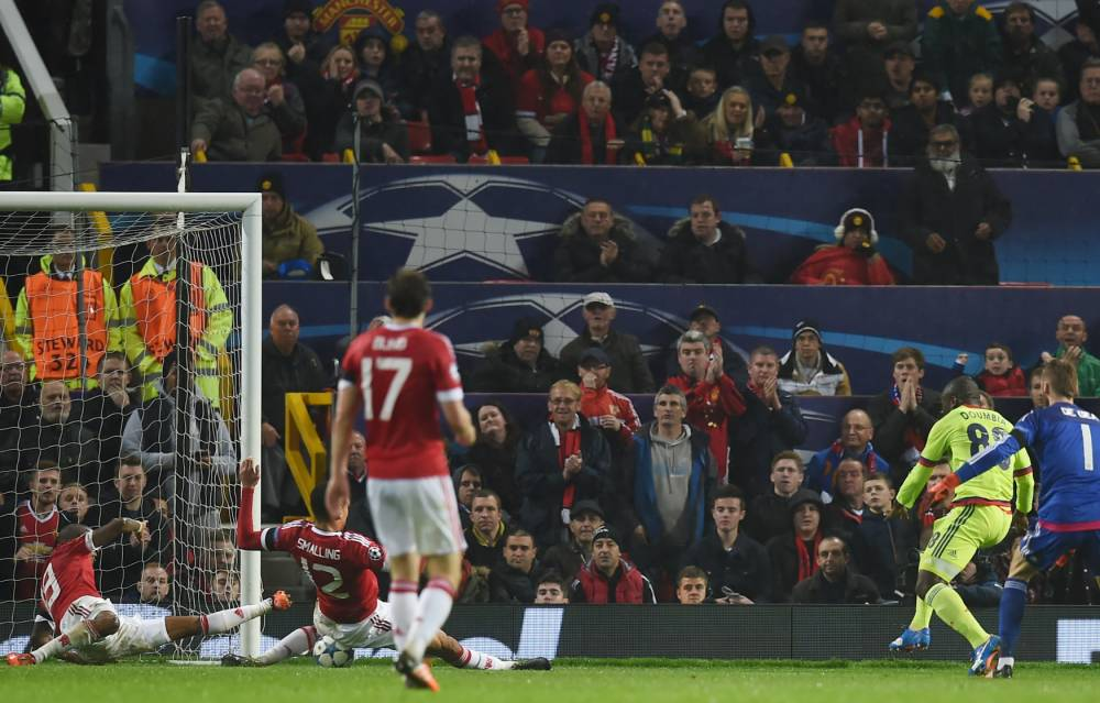 Manchester United's English defender Chris Smalling (2L) blocks a shot by CSKA Moscow's forward from Ivory Coast Seydou Doumbia (2R) during a UEFA Chamions league group stage football match between CSKA Moscow and Manchester United at Old Trafford in Manchester, north west England on November 3, 2015. AFP PHOTO/PAUL ELLISPAUL ELLIS/AFP/Getty Images