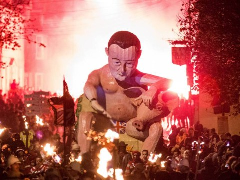 A massive effigy of David Cameron and a pig was set on fire last night