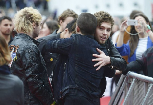 LONDON, ENGLAND - NOVEMBER 08: Nick Jonas greets Luke Hemmings of 5 Seconds of Summer during the BBC Radio 1 Teen Awards at Wembley Arena on November 8, 2015 in London, England. (Photo by Dave J Hogan/Dave J Hogan/Getty Images)