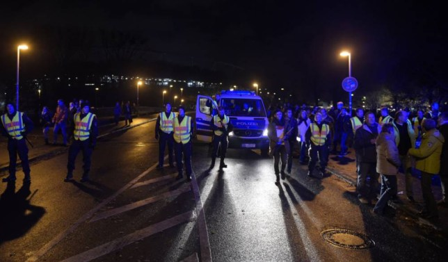 Police secures the area as supporters leave the stadium after the friendly football match Germany vs the Netherlands was called off for 'security reasons' in Barsinghausen on November 17, 2015. AFP PHOTO / ODD ANDERSENODD ANDERSEN/AFP/Getty Images
