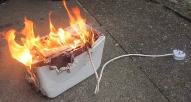 MEN SYNDICATIONnPic shows Suzanne Dale, 66, from Sale, Greater Manchester, who saw a tip on Facebook on how to use a toaster on its side to make cheese on toast and almost burnt down her kitchen.