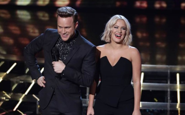 *** MANDATORY BYLINE TO READ: Syco / Thames / Corbis ***<BR /> The X Factor Live Finals, London, Britain - 21 November 2015 <P> Pictured: Olly Murs and Caroline Flack <B>Ref: SPL1182206 211115 </B><BR /> Picture by: Syco/Thames/Corbis/Dymond<BR /> </P><P>