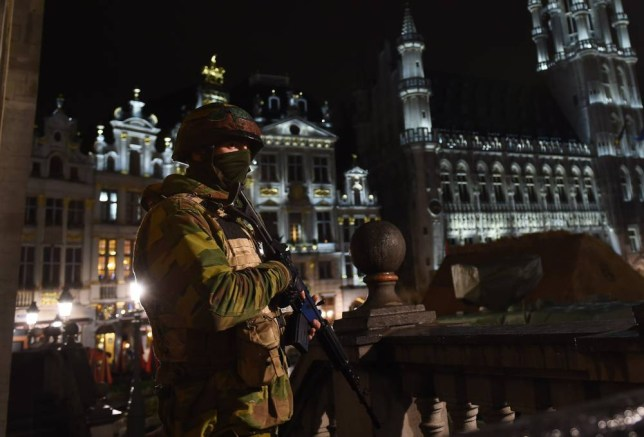 """A Belgian soldier stands guard around a security perimeter as a reported police intervention takes place around the Grand Place central square in Brussels on November 22, 2015. Brussels will remain at the highest possible alert level with schools and metros closed over a """"serious and imminent"""" security threat in the wake of the Paris attacks, the Belgian prime minister said. AFP PHOTO / EMMANUEL DUNANDEMMANUEL DUNAND/AFP/Getty Images"""