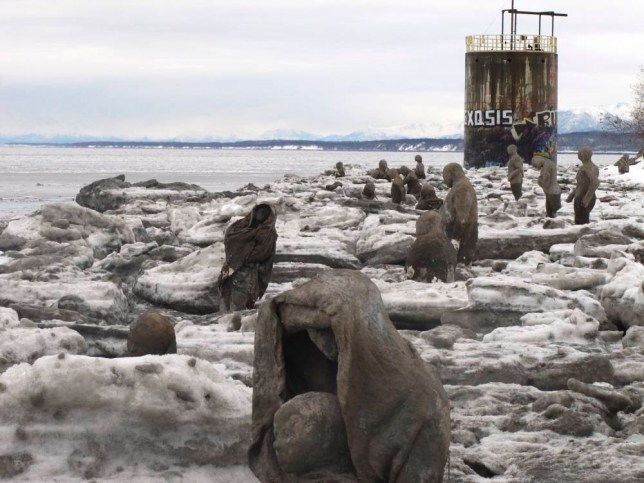 Sculptures made of straw, cement, plaster and burlap are part of a public art installation Tuesday, Nov. 24, 2015, at Point Woronzof in Anchorage, Alaska. Lead project artist Sarah Davies says the display of 85 sculptures will officially open Dec. 5 and represents people dealing with emotional vulnerabilities, including trauma and mental illness. (AP Photo/Rachel D'Oro)