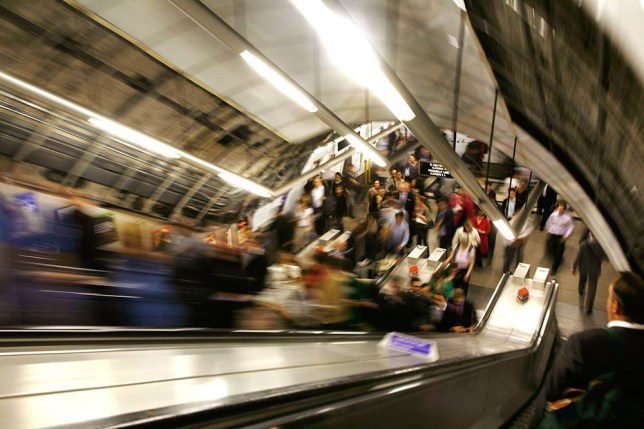 AX6XFX Commuters travelling up the escalators at Holborn tube station, London