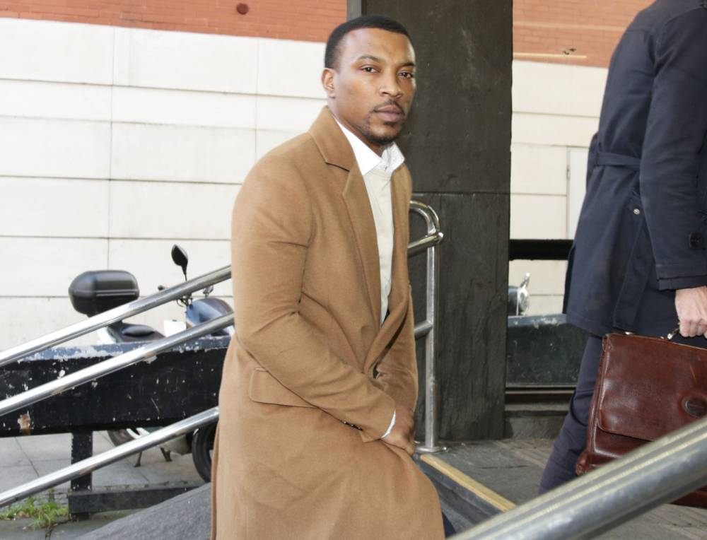 """Actor and musician Ashley Walters arriving at Highbury Corner Magistrates' Court, north London, where he has denied racially abusing a hotel receptionist and threatening her manager. PRESS ASSOCIATION Photo. Picture date: Thursday November 26, 2015. The 33-year-old, who plays an officer in BBC police drama Cuffs, called a member of staff at the Hilton hotel in Islington, north London, a """"white bitch"""", it is claimed. Photo credit should read: Yui Mok/PA Wire"""
