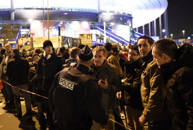 Football fans gather outside of the Stade de France stadium, following the friendly football match between France and Germany in Saint-Denis, north of Paris, on November 13, 2015, after a series of gun attacks across Paris as well as explosions outside the national stadium where France was hosting Germany. Three loud explosions were heard outside France's national stadium during the first half of a friendly international football match between France and Germany. At least four people died outside the glittering venue which staged the 1998 World Cup final with several others seriously hurt. AFP PHOTO / FRANCK FIFE (Photo credit should read FRANCK FIFE/AFP/Getty Images)