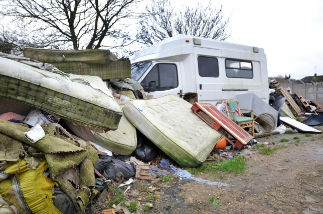 """LUTON, UNITED KINGDOM - DECEMBER 11: General view pictured on December 11, 2015 showing an area where there is even an old ambulance buried in the fly tipping contents at Dallow Road, Luton, England Luton has an immaculate town center, the streets surrounding the shopping area are cleaned almost until they shine. But walk just outside of that area and the town is filthy. Fly tipping is rife and some shop keepers leave a terrible mess at the rear of their premises. The town is possibly one of the foulest places to live in in the UK. Local residents are reportedly to have said: """"Luton needs to clean up and fast and needs to prosecute those who break the laws"""". In the meantime, the Christmas shoppers will enjoy clean shopping areas but those outside of the golden oblong that makes up the shopping area will continue to live in waste. PHOTOGRAPH BY Tony Margiocchi / Barcroft Media UK Office, London. T +44 845 370 2233 W www.barcroftmedia.com USA Office, New York City. T +1 212 796 2458 W www.barcroftusa.com Indian Office, Delhi. T +91 11 4053 2429 W www.barcroftindia.com"""