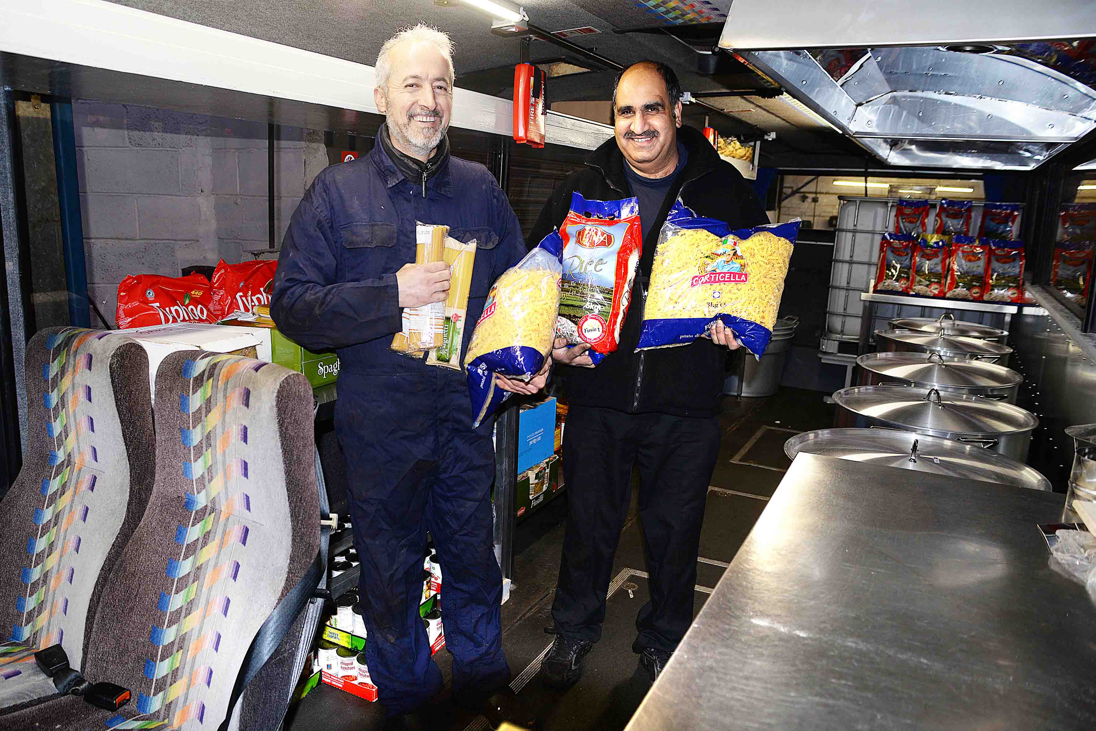 Take a look at this bus which has been converted into a travelling kitchen. nGhafoor Hussain from Stockton has spent thousands of pounds of his own money buying and transforming a single-decker bus into this moving canteen so he can feed thousands of refugees this Christmas. nAnd the 45-year-old will embark on the journey today - one that will take him away from his family for at least three weeks. n¿About four weeks ago I took a van full of food to the refugees in Austria, Slovenia and Croatia,¿ said Ghafoor, a dad of four and grandad of three. n¿While I was there I discovered that the people were mostly only getting cold meals. nnGhafoor Hussein of Stockton is travelling through Europe feeding refugees using a coach which has been kitted out with a kitchen, along with volunteers he sets off on Friday (18th December).nPictured (left) volunteer Bamo Ghafari and Ghafoor Hussein.