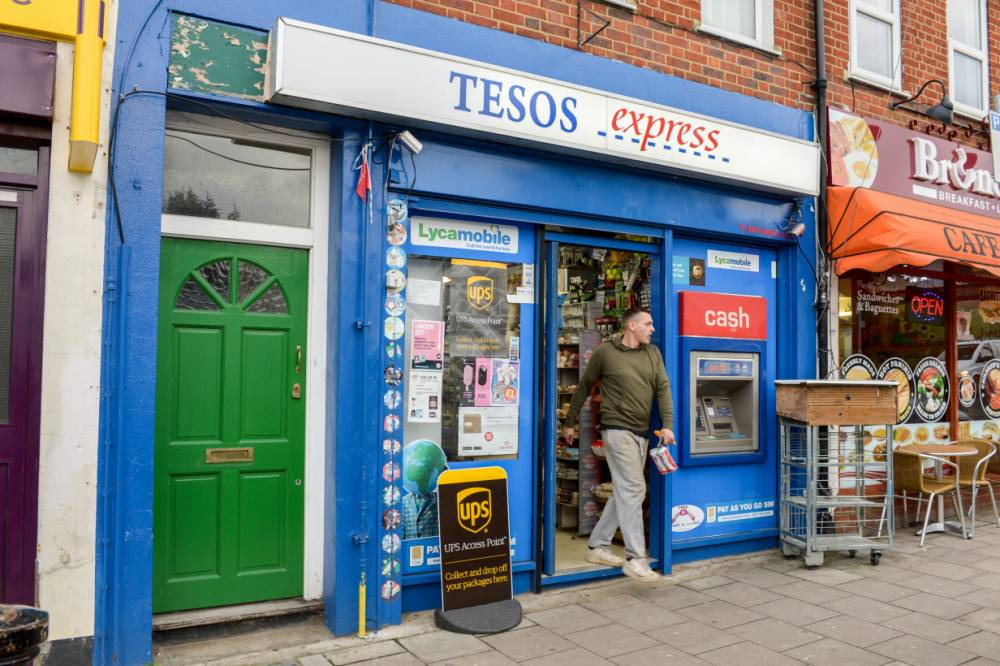 General views of the Tesos Express in Surbiton, London. See SWNS story SWTESOS; A cheeky shop owner could have landed himself in hot water after changing the name of his store ñ to TESOS EXPRESS. The store was previously known as Union Convenient Off Licence until a rebrand last year gave it an uncanny similarity to Tesco Express. The store in Surbiton, south west London, has caused customers to joke on Twitter, especially because the logos share a distinct similarity. Matt Copperwaite tweeted: ìOff to my local TESOS Express ñ no that's not a typo but probably is a trademark dispute.î