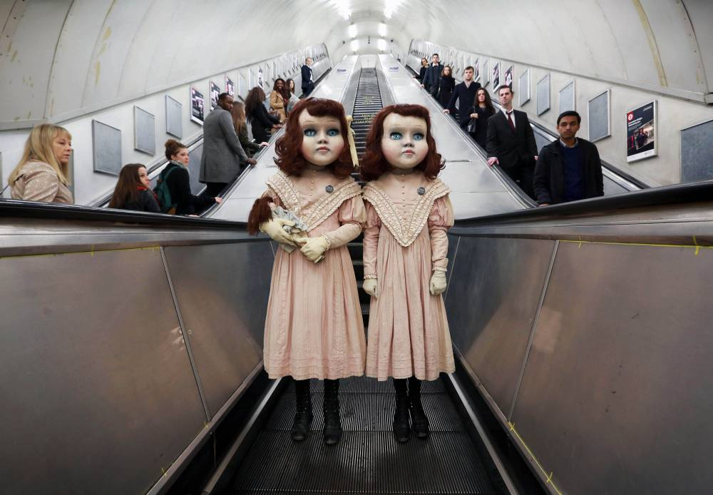EDITORIAL USE ONLY Two life-size Victorian style dolls shocked Londoners this morning as the creepy pair popped up at commuter hotspots across the capital to mark the launch of the worldís first psychological theme park ride created by Derren Brown, coming to Thorpe Park Resort in 2016. PRESS ASSOCIATION Photo. Picture date: Thursday December 3, 2015. The incredibly realistic 4ft 7î high ëliving dollsí were played by two models who each spent over three hours being transformed by a top team of stylists, costume designers, make-up artists and dressers. The dolls were spotted at numerous venues in London including Charing Cross Tube Station, Oxford Circus, Regents Street and Hamleys where they were seen playing with a toy train set, carrying dolls and pushing an empty 1900ís style pram. Visitors to the ëthemedí experience at Thorpe Park Resort in 2016 will embark on a 13 minute journey, making the one-of-a-kind attraction a totally unique theme park experience. Photo credit should read: Matt Alexander/PA Wire