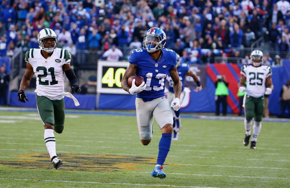 EAST RUTHERFORD, NJ - DECEMBER 06: Odell Beckham #13 of the New York Giants scores a touchdown in the second quarter against the New York Jets during their game at MetLife Stadium on December 6, 2015 in East Rutherford, New Jersey. (Photo by Al Bello/Getty Images)