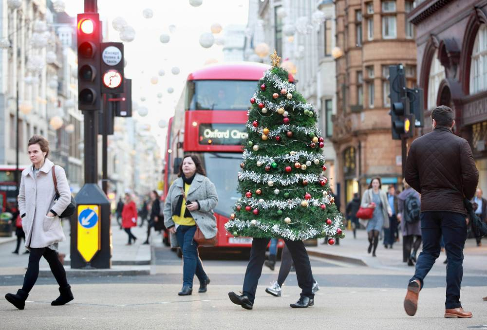 EDITORIAL USE ONLY A man walks down Oxford Street in London to demonstrate the Christmas Party Escape Suit, which is a wearable Christmas tree costume designed to help people discreetly exit dull office parties - created by LateRooms.com ahead of tomorrow, the biggest Christmas party night. PRESS ASSOCIATION Photo.¿Picture date: Thursday December 17, 2015. Research compiled by the online hotel reservations website revealed that three quarters of the British public dread their office party, with being made to pay for your own drinks and food topping the poll. Photo credit should read: Matt Alexander/PA Wire