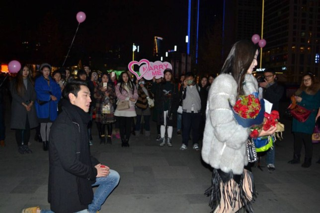 """Pic shows: the woman turned around and left the scene. A boyfriend's elaborate wedding proposal flopped when he was photographed getting down on one knee to ask his girlfriend to marry him, and was turned down because the diamond on the ring was too small. The young man had hired dancers to perform in front of the girl in an elaborate ritual and he then emerged from among them to get down on one knee and hand over the ring. The young woman initially seems overcome by the performance on a street in Chengdu, the capital city of south-west China's Sichuan province, and one point started to cry as her boyfriend walked towards her. But when he went down on one knee and held up the box, opening the ring for her to see, she was less than impressed. One eyewitness told local TV: """"Her eyes went wide as she put her hand over her mouth, and then she turned around and walked away without saying anything."""" A screenshot of a WeChat conversation allegedly between her and a friend was later leaked online and published alongside the story. In the message, the girlfriend says: """"But he agreed to buy me a diamond ring as large as one carat. Why was this one so small? Is he so careless or has he ever cared about me?"""" Her friend replies: """"Don't worry. Perhaps the bigger one will be waiting for you later or he hasn't prepared it for this time."""" (ends)"""